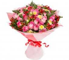 Blazing roses and hypericum berries opulent bouquet